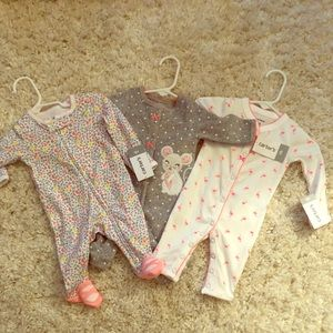 Newborn coveralls. Carters. Brand new with tags!